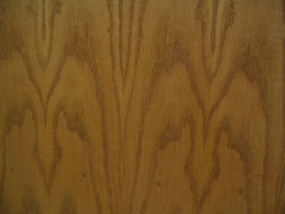 Large repeating patterns suggest a veneer.