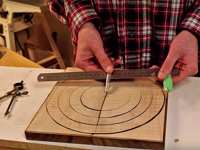 Begin laying out the rings by drawing the largest possible circle and work inward.